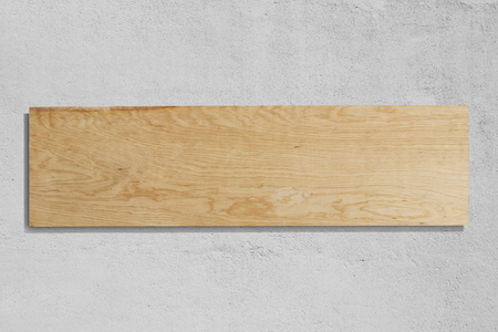 Rectangular plywood sign with rough wall background.