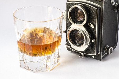 Whiskey glass with a vintage camera photo