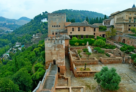 renowned: The Alhambra a Moorish citadel and palace is in Granada. It is the most renowned building of the Andalusian Islamic historical legacy with its many cultural attractions that make Granada a popular destination among the touristic cities of Spain. Stock Photo