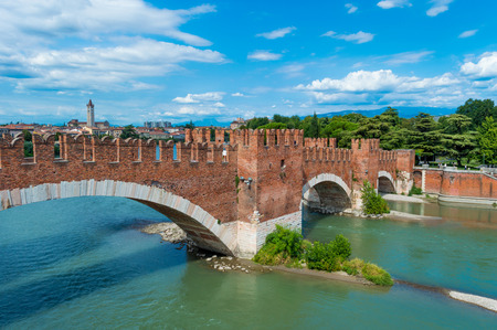 approximately: Verona is a city straddling the Adige river in Veneto, northern Italy, with approximately 265,000 inhabitants and one of the seven chef-lieus of the region.  Stock Photo