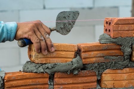 Workers with brick wall Stock Photo