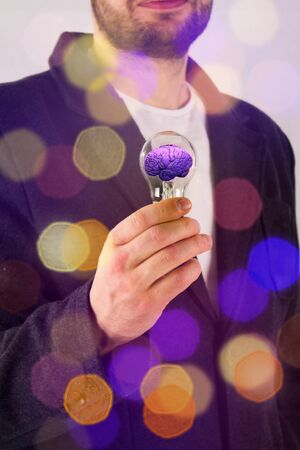 Man in suit holding light bulb. Electric power and new technology concept. Development of new technologies.
