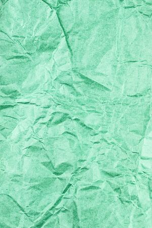 Crumpled green paper unfolded. | Texture of old crumpled and unfolded paper.