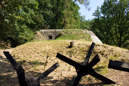 Light fortification building - bunker and an anti-tank hedgehogs in the city of Kladruby in the Czech Republic.