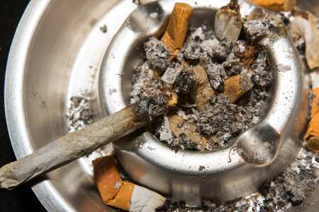 ashtray: Cigarette laying in ashtray