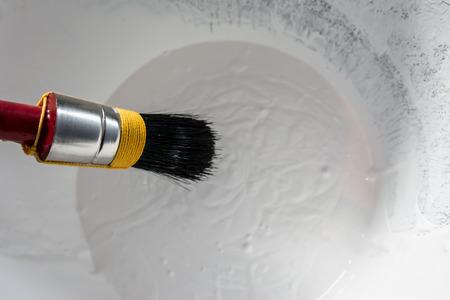 brush in: Paint brush in paint bucket