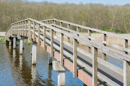 bridge over water: Wooden bridge over water in forrest