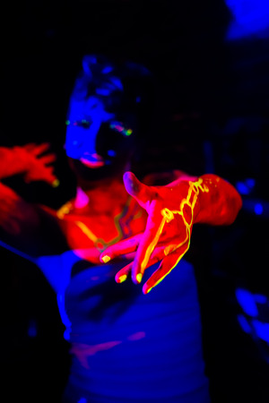 Female dancer with fluorescent makeup photo
