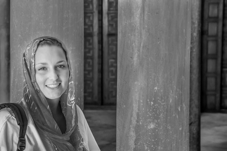 kerchief: Beautiful young woman wearing kerchief in a mosque in Tunisia, in black and white