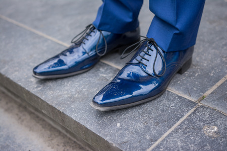 elegantly: Blue male leather lacquered shoes from groom