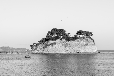 Island in Agios Sostis in Zakynthos, Greece with the wooden bridge in black and white