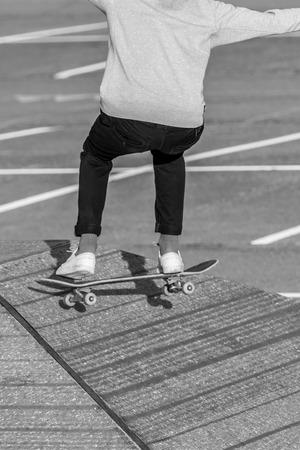 Skateboarder on ramp in black and white