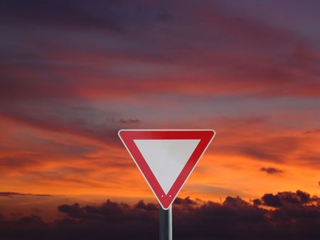 right of way sign in front of a sunset                                Stock Photo