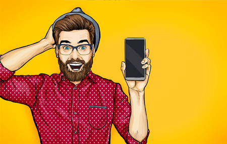Attractive smiling hipster in specs with phone in the hand in comic style. Pop art man in hat holding smartphone. Digital advertisement for a cellphone.
