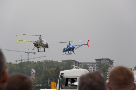 air show: Choppers over the runway during air show Editorial