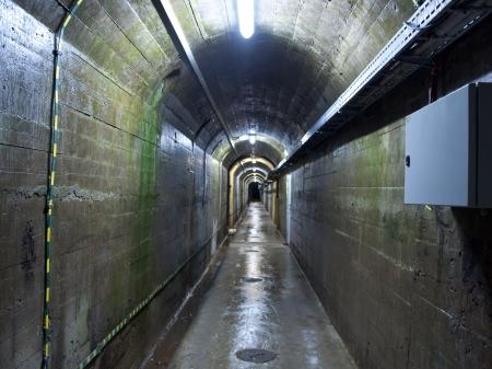 Iluminated tunnel under the dam photo
