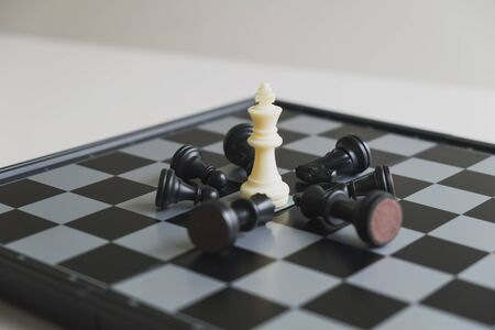 Chess pieces on board with white background, driven to success Business Strategy.