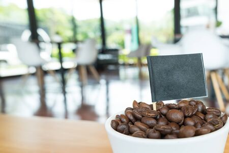Coffee beans  from the cup with black flag, ready to give freshness and alongside the businessmen.