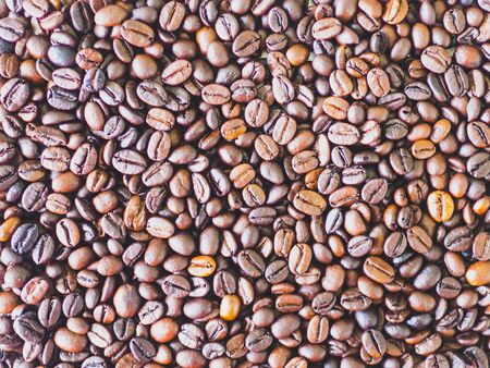close up of Roasted coffee beans isolated background.