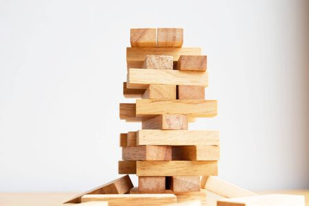 Wood block tower with architecture model, Planning Alternative Risk and Strategy in Business concept.