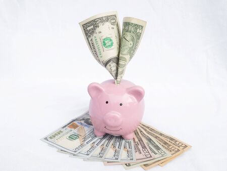 pink piggy bank with dollars bank note, Saving money for future plan and retirement fund concept.