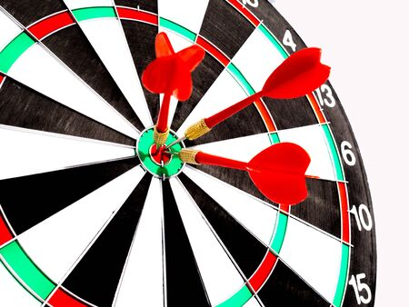 Target with three red dart focus on bull's eye, Setting challenging business goals And ready to achieve the goal with teamwork concept. Banque d'images