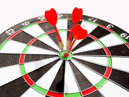 Target with three red dart focus on bull's eye, Setting challenging business goals And ready to achieve the goal with teamwork concept.