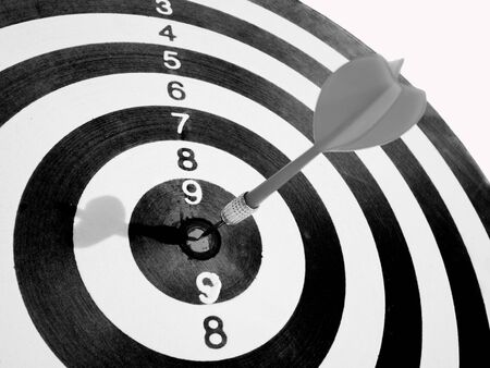 black and white Target with a dart focus on bull's eye, Setting challenging business goals And ready to achieve the goal concept.