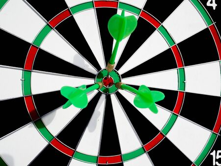 Target with three green dart focus on bull's eye, Setting challenging business goals And ready to achieve the goal with teamwork concept. Stock Photo