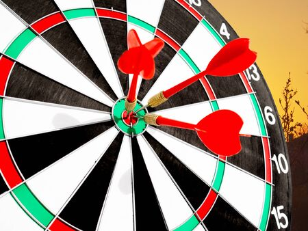 Target with red dart focus on bull's eye, Setting challenging business goals And ready to achieve the goal concept.