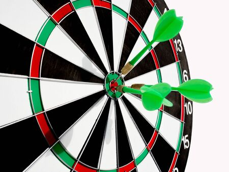 Target with three green dart focus on bull's eye, Setting challenging business goals And ready to achieve the goal with teamwork concept.