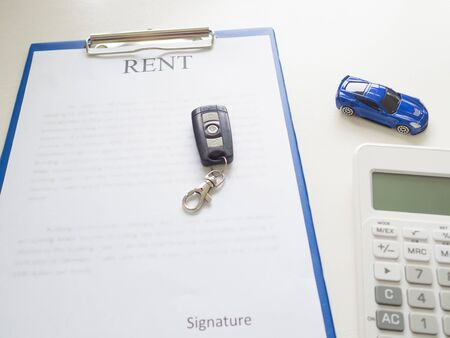 A car rent service lease contract with key and calculator