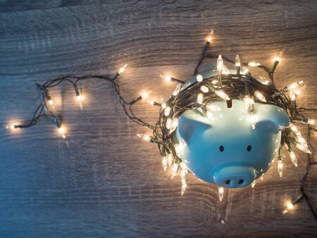 Blue piggy bank with Party lights, Enjoy savings for the holidays concept.