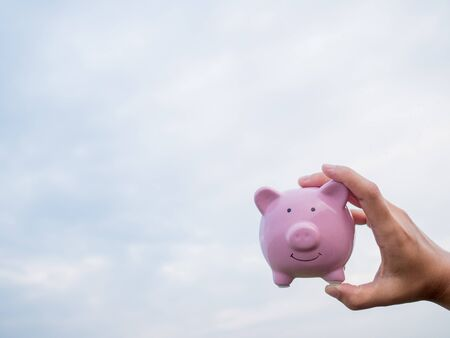 pink piggy bank on the blue sky with cloud background, Saving money for future plan and retirement fund concept. Zdjęcie Seryjne