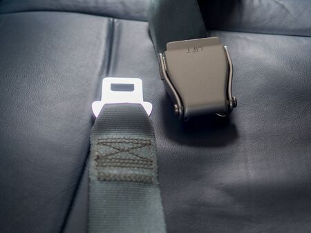 Safety seat belts on airplane chairs, Transportation and vehicle concept.