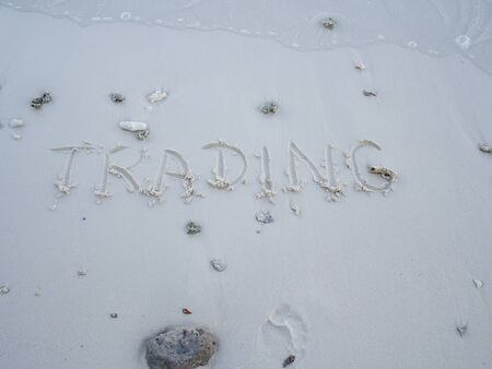 The letters trading were written on the sand with natural beauty.