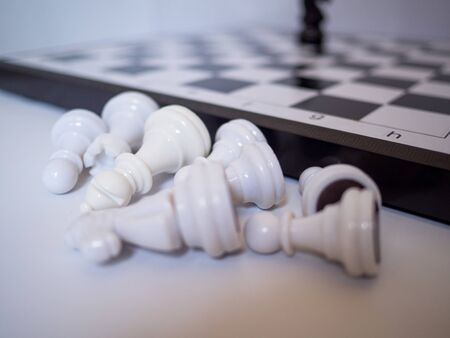 Chess board and chess figures on white background, challenges planning business strategy to success concept.