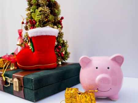 Christmas tree and pink piggy bank with decoration on white background, Have a nice holiday on this Christmas. Stock Photo