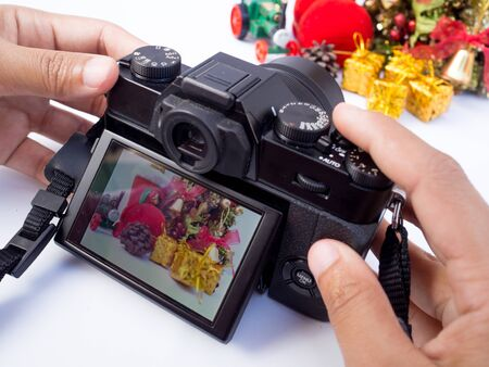 The photographer is intending to use digital camera take pictures of the Christmas decoration, Have a nice holiday on this Christmas. Reklamní fotografie