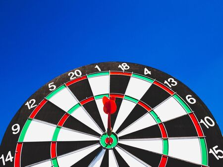 Dart Board Isolated on blue sky background, Setting challenging business goals And ready to achieve the goal concept.