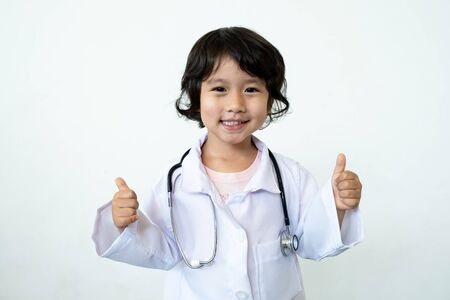 Photo of kid doctor with stethoscope on white background.