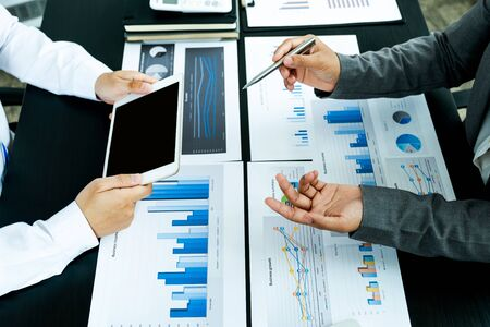 businessmen and businesswomen team meeting to plan strategies to increase business income. Have a brainstorming graph analysis and discussing for the new target success. Stock fotó