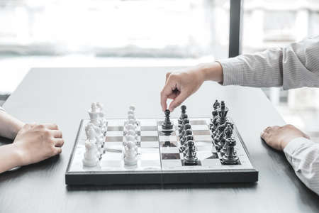 hand move chess with strategy and tactic to win enemy, play battle on board game, business opportunity competition strategic challenge concept.