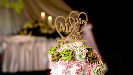 wedding cake for the bride and groom couple cut in the wedding party event at a restaurant or church. 스톡 콘텐츠