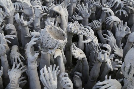 archtecture: The hands sculpture in white temple in Chiang Rai, thailand