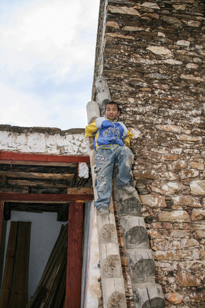stockade: the native boy on the watchtower in danba,sichuan,china
