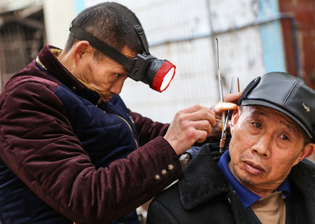 chengdu: ear cleaning in ancient town, chengdu, china