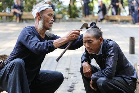 miao: Sickle haircut in basha miao village,guinzhou,china