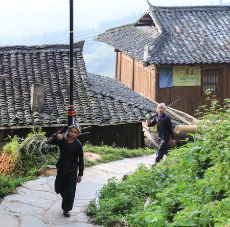 miao: men taking guns in basha miao village,guinzhou,china