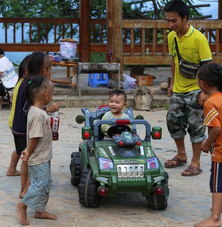 miao: boys playing in basha miao village,guinzhou,china